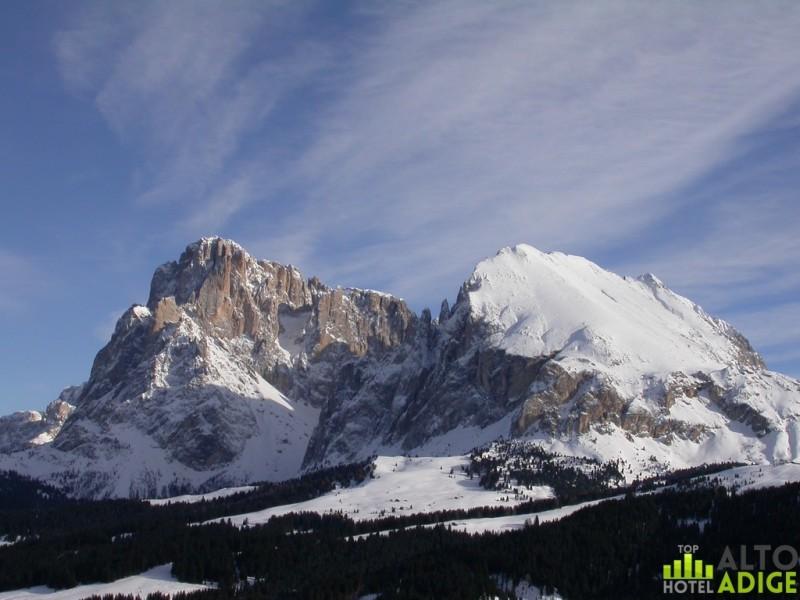 Sassolungo and Sassopiatto in winter from Seiser Alm