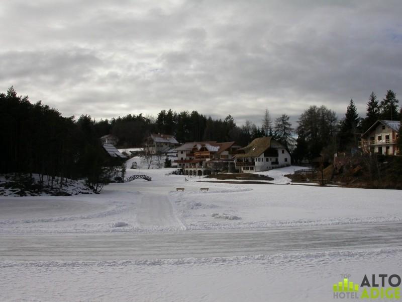The small alpine lake Costalovara plateau of Renon