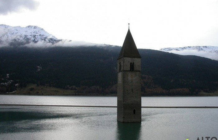 Photo Gallery South Tyrol The bell tower that rises from the waters of Lake Reschen in Val Venosta